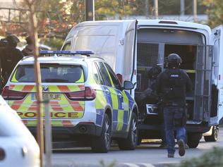 "Police at the scene at Bermuda Park in Nuneaton, central England, where they are dealing with an ongoing incident, Sunday Oct. 22, 2017. A police department in central England says a reported hostage-taking incident at a bowling alley is ""unconnected to any terrorist activity."" (Aaron Chown/PA via AP)"