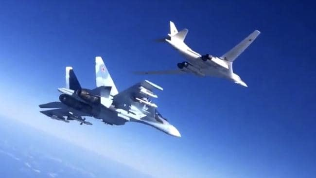 Long reach ... A Russian air force Tu-160 bomber, right, is escorted by an Su-30SM fighter on a combat mission against a target in Syria.