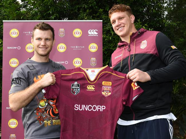 Boxer Jeff Horn (left) is presented with a Queensland jumper from Dylan Napa.