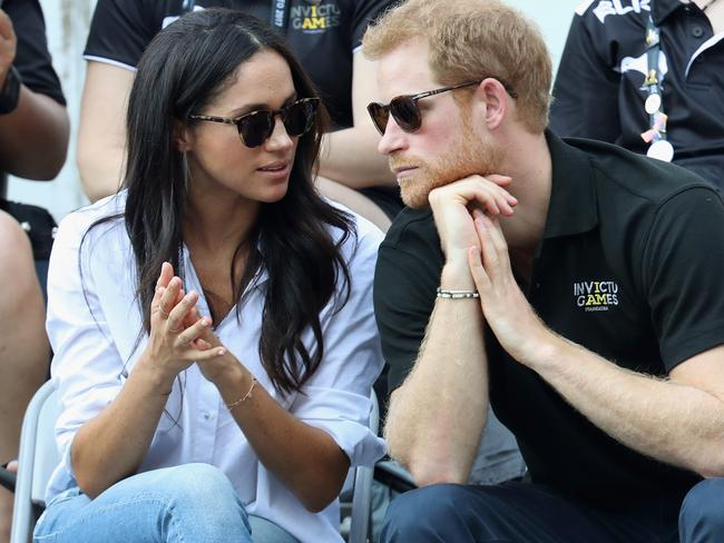 Prince Harry (R) and Meghan Markle (L) attend a Wheelchair Tennis match during the Invictus Games 2017. Picture: Getty