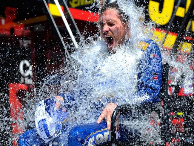 Racing car driver Brian Vickers, driver of the #55 Aaron's Dream Machine Toyota, participates in the ALS Ice Bucket Challenge.