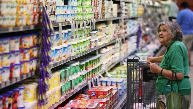 A shopper looks at a display of dairy products at a supermarket in Sydney. Picture: Bloomberg.