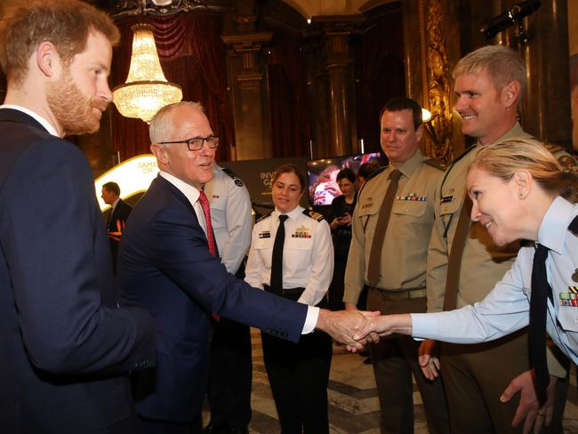 The PM and the prince meet serviceman at the reception at Australia House.
