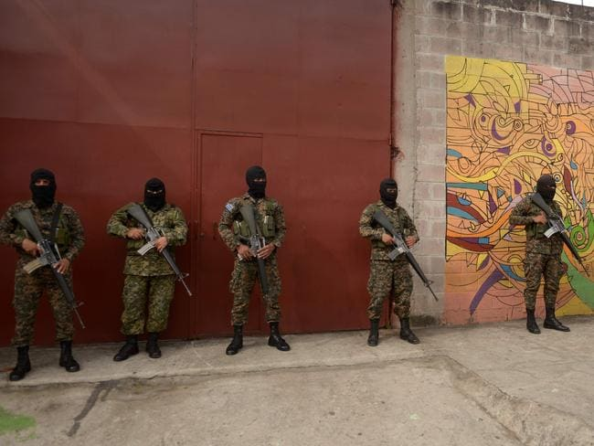 Soldiers during a campaign to clean up graffiti associated with the Mara Salvatrucha gang in Quezaltepeque, a town 15km from San Salvador. Picture: AFP