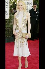 Nicole Kidman in a whole lotta sequins and gold at the attends the 2004 Golden Globes. Picture: Carlo Allegri/Getty Images