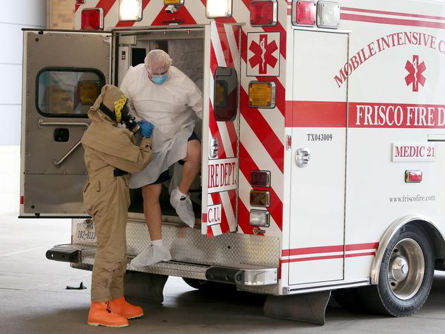 Symptoms ... Michael Monning is brought to the Texas Health Presbyterian Hospital in Dallas, Texas. Pic: Joe Raedle/Getty Images/AFP