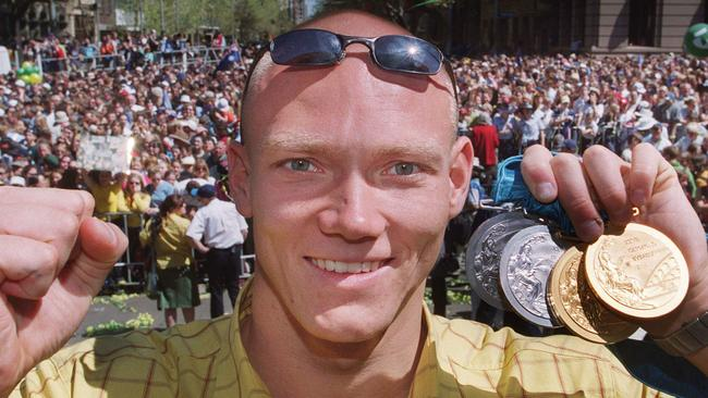 Michael Klim with his Sydney 2000 medals during the tickertape parade in Sydney.