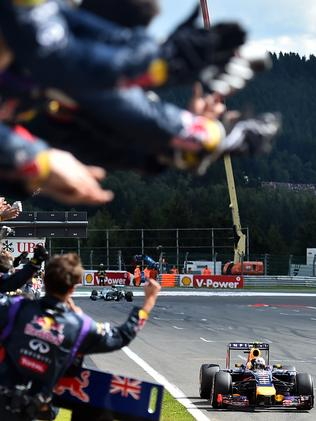 Red Bull cheer Ricciardo over the line.