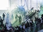 Saint-Etienne's fans invade the stadium during the French L1 football match played behind closed door between AS Saint-Etienne and Stade Rennais FC, on April 23, 2017 at the Geoffroy Guichard stadium in Saint-Etienne, central France. AFP PHOTO / PHILIPPE DESMAZES