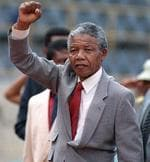 <p>A picture taken on February 25, 1990 shows anti-apartheid leader and African National Congress (ANC) member Nelson Mandela raising his fist as he arrivess to address a mass rally, a few days after his release from jail, in the conservative Afrikaaner town of Bloemfontein, where the ANC was formed in 1912.</p>