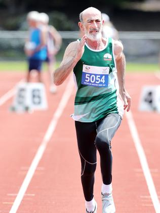 Alan Coleman, of Hobart, during the 65-69-year-old 60m race.