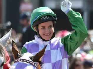 (FILES) A file photo taken on November 3, 2015, shows jockey Michelle Payne celebrating after becoming the first female jockey to win the Melbourne Cup, in Melbourne. Melbourne Cup-winning jockey Michelle Payne is undergoing tests in hospital after falling during a race and complaining of acute abdominal pain, sparking fears of internal injuries, racing officials said May 24, 2016. Australia's Payne -- the first woman to win the 155-year-old Melbourne Cup last year -- tumbled from her horse Dutch Courage at Mildura in northwest Victoria state on Monday and was taken to a nearby hospital. / AFP PHOTO / PAUL CROCK / IMAGE RESTRICTED TO EDITORIAL USE - STRICTLY NO COMMERCIAL USE