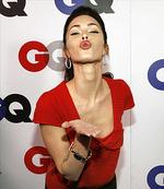 <p>She knows how to get your attention .. Megan blows a kiss with her bright red pouty lips!</p>