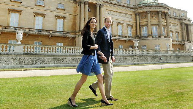 Prince William and his wife Kate, the Duchess of Cambridge, walk hand in hand from Buckingham Palace in London, before departing for their honeymoon. Picture: AFP