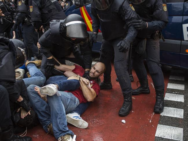 People clash with Spanish police officers in Barcelona. Picture: AFP/Fabio Bucciarelli