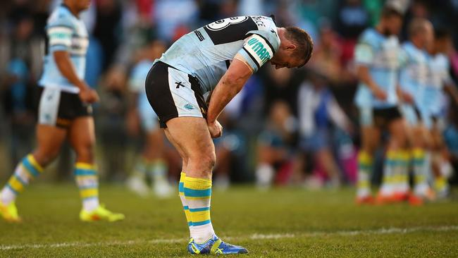 Paul Gallen cuts a dejected figure after carrying an injury through Cronulla's loss to the Knights. Pic: Mark Nolan/Getty Images