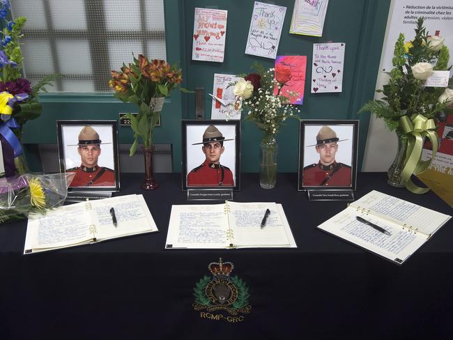Shot dead ... Books of condolence for RCMP Constables Fabrice Georges Gevaudan, Douglas James Larche and David Joseph Ross.