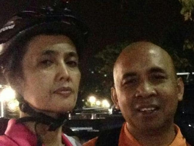 Childhood sweethearts ... Capt Zaharie Ahmad Khan goes on a night cycle with his wife, Faizah Khanum.
