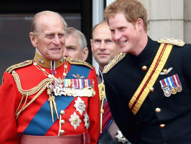 Prince Harry and Prince Philip, Duke of Edinburgh share a joke at Queen Elizabeth II's birthday parade in 2014. Picture: Getty