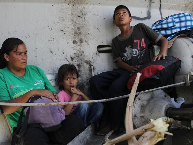 Moving on ... a Central American immigrant and her children sit inside the so-called La Bestia (The Beast) cargo train, in an attempt to reach the Mexico-US border. Picture: Elizabeth Ruiz