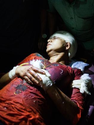 Injured ... Rafida Ahmed is carried on a stretcher after she was attacked by unidentified assailants. Picture: AFP/Rajib Dhar