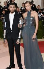 "Zayn Malik, left, and Gigi Hadid arrive at The Metropolitan Museum of Art Costume Institute Benefit Gala, celebrating the opening of ""Manus x Machina: Fashion in an Age of Technology"" on Monday, May 2, 2016, in New York. Picture: Evan Agostini/Invision/AP"