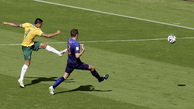 Australia's Tim Cahill smashes in his volley.