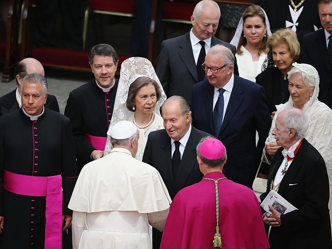 Royal watchers ... Pope Francis greets King Juan Carlos and Queen Sofia of Spain (L) followed by King Albert II (back C) and Queen Paola (R) of Belgium after the canonisation in which John Paul II and John XXIII were declared saints.