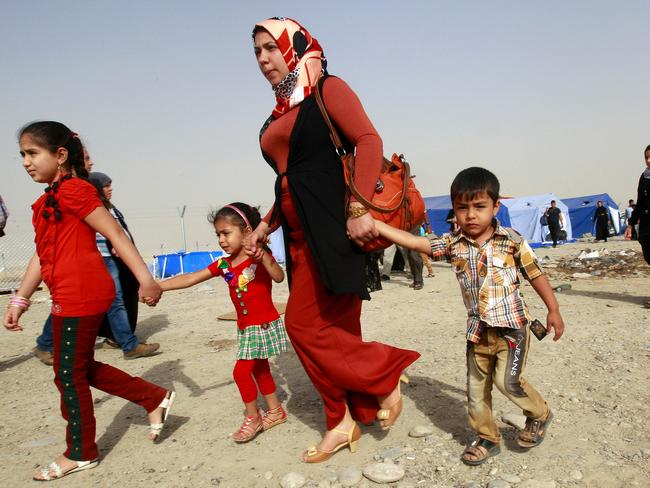 Refugees flee Mosul after the unrest in Iraq. Picture: AP
