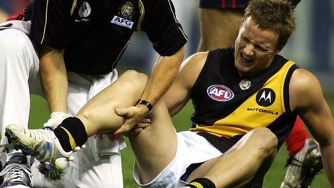 Richmond's Nathan Brown with medical staff after breaking his leg against Melbourne in 2005. Picture: Wayne Ludbey