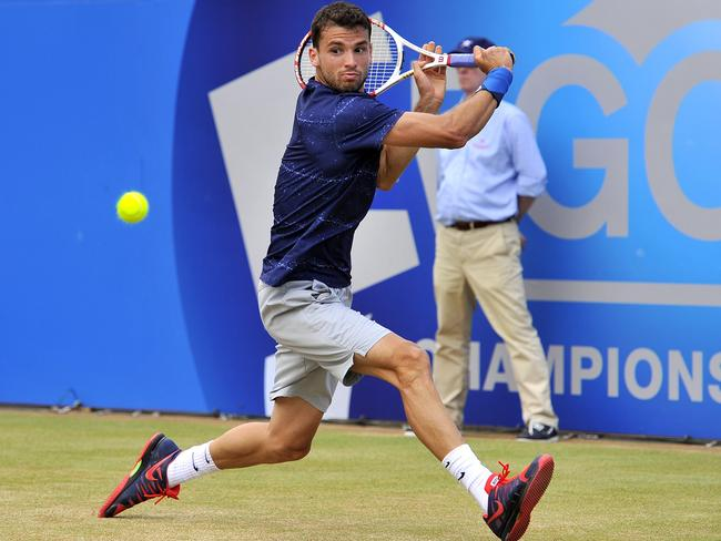 Dimitrov plays a shot during his semi-final match at The Queen's Club. Picture: Glyn Kirk