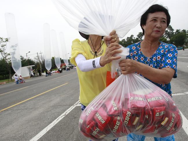 North Korean defectors prepare to release a balloon en route to the North, carrying chocolate pies. Picture: Ahn Young-joon