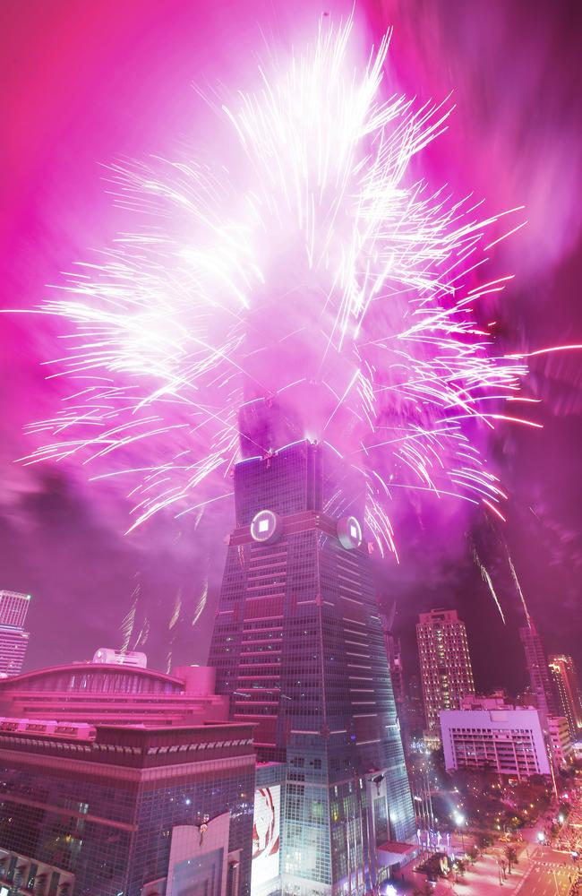 Tickled pink ... the Taipei 101 skyscraper in Taipei, Taiwan, was transformed during the new year's spectacular. Picture: AP Photo/Wally Santana