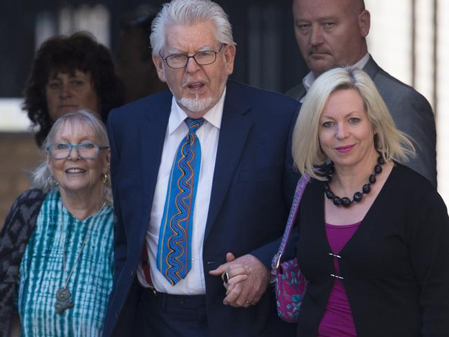 Rolf Harris (C), with wife, Alwen Hughes, left, and daughter Bindi, who have stood by the entertainer. Picture: Getty