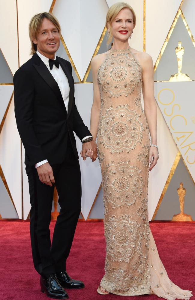 Naked dress. Nicole Kidman, pictured with her husband Keith Urban, wearing Armani Prive at this year's Oscars.