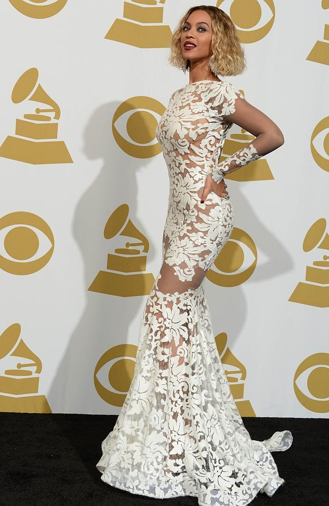 Singer Beyonce Knowles poses in the press room during the 56th Grammy Awards at the Staples Center in Los Angeles on January 26, 2014. AFP PHOTO/Joe KLAMAR