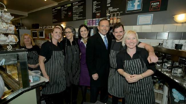 Tony Abbott poses with candidate Sarah Henderson and staff at a local cafe in the Geelong suburb of Highton.