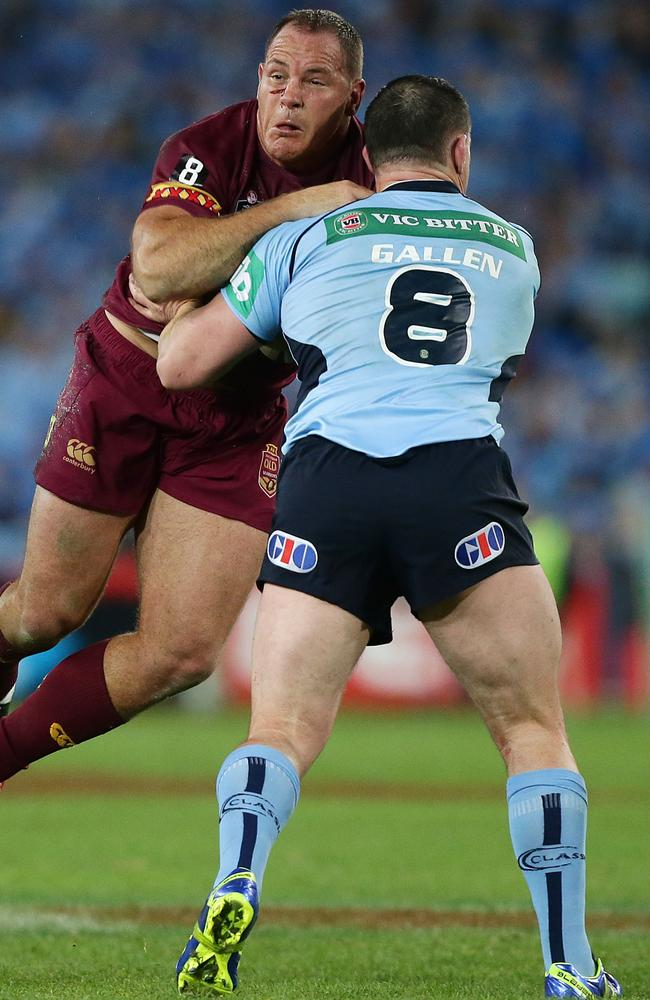 Matt Scott runs into Paul Gallen.
