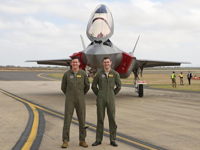AVThe two pilots of Australia's F-35s pose in front of the aircraft on March 3, 2017 during their public debut at the Avalon Air Show. Picture: Scott Barbour / Getty