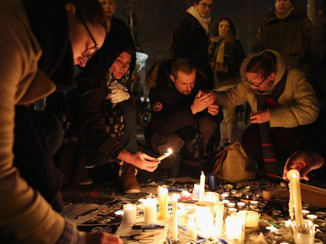 People hold a vigil at the Place de la Republique (Republic Square) for victims of the terrorist attack. Picture: Dan Kitwood/Getty Images