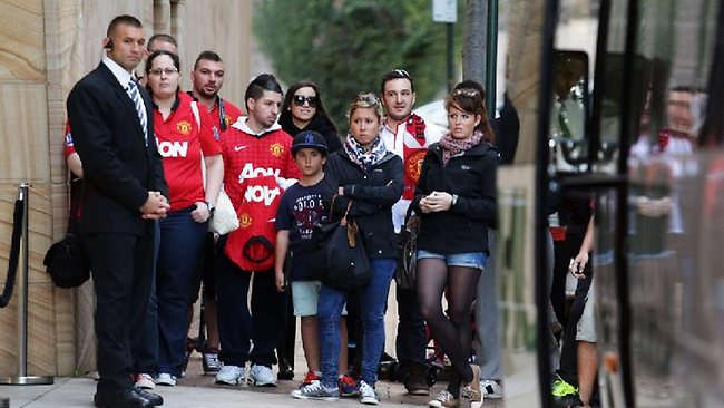 Manchester United fans wait outside the team's hotel in Sydney today. Picture: Adam Taylor