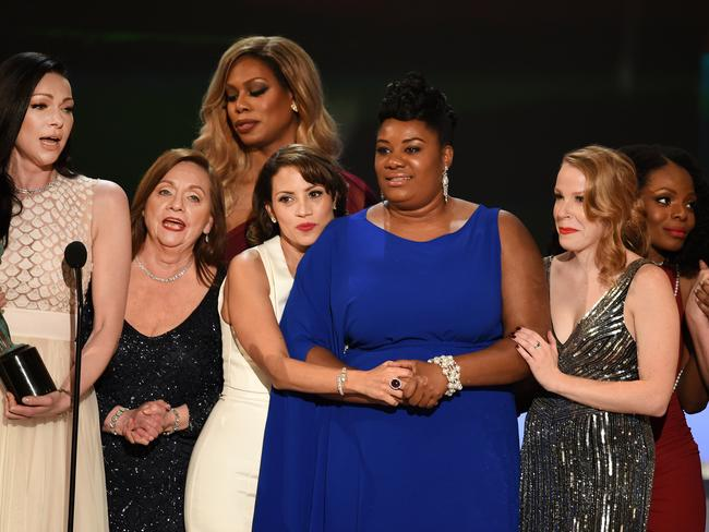 The cast of 'Orange Is The New Black' accept the award for Oustanding Ensemble in a Comedy Series. Picture: Kevin Winter/Getty Images