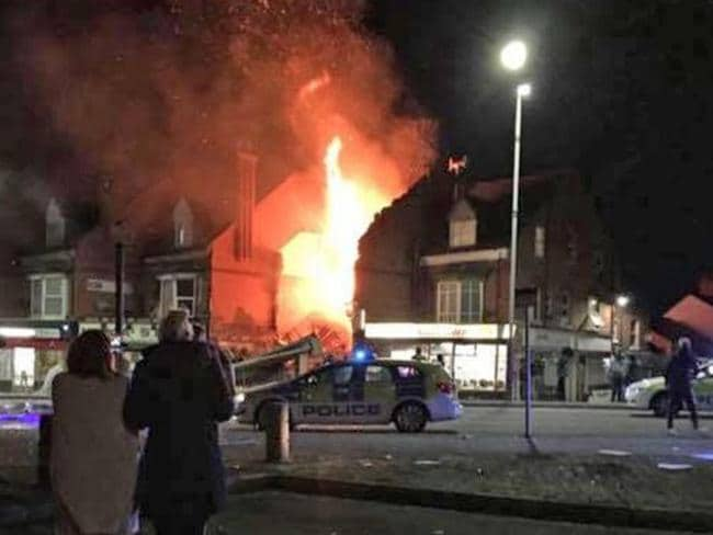 Residents stand in the street overlooking the scene of the explosion in Leicester city. Picture: Facebook