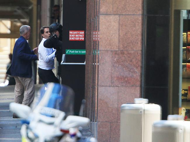 Calculated man ... Man Haron Monis had plans years ago. Here, police are depicted at the scene of the siege in Martin Place. Picture: Toby Zerna