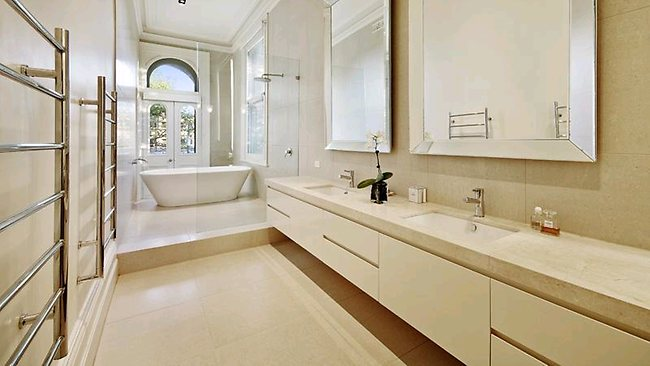 VIZARD'S ST KILDA MANSION: The French-style sparkling cream-stone bathroom has plenty of room and mirrors.