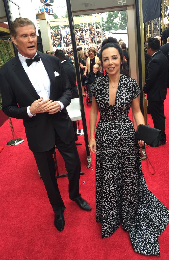 Michele Manelis interviewed The Hoff at the Golden Globes earlier in the week, where he keep stepping on her gown. Her dress is by Shekhar Rahate, and jewels by Reign Sapphires.