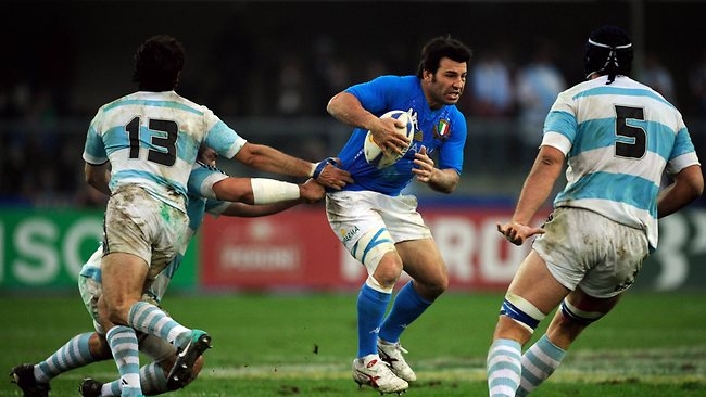 In this file picture from 2011, Craig Gower dodges Argentina's best during a test match in Verona.