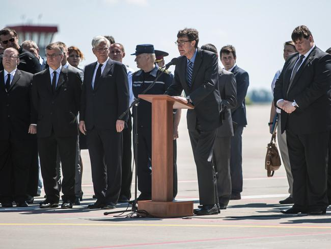 Long journey ... Angus Houston, Australia's Special Envoy in Ukraine, speaks at a departure ceremony for the victims of the crash of MH17 to the Netherlands in Kharkiv, Ukraine. Picture: Getty