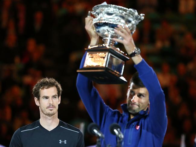 Australian Open champion Novak Djokovic of Serbia holds the Norman Brookes Challenge Cup as Andy Murray of Great Britain looks on. (Photo by Scott Barbour/Getty Images)