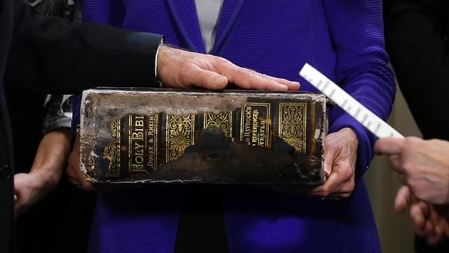 Vice President Joe Biden, left, places his hand on the Biden Family Bible held by his wife Jill Biden, center, as he takes the oath of office from Supreme Court Justice Sonia Sotomayor, right, during and official ceremony at the Naval Observatory, Sunday.